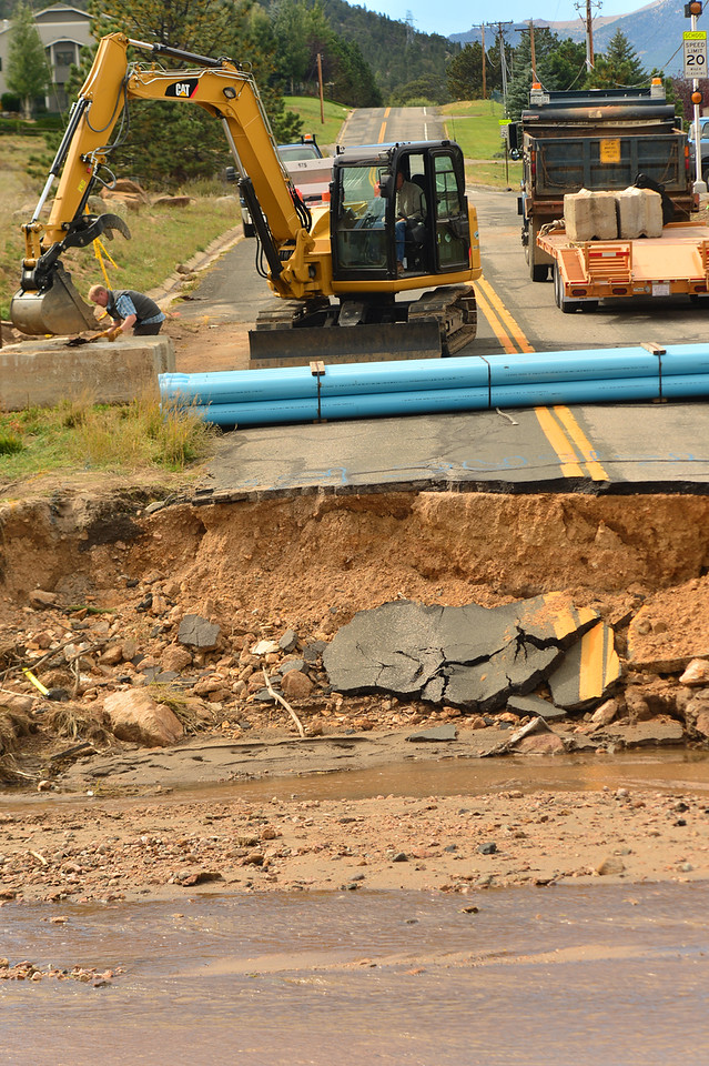Roads crews prepare for the task ahead; reconnecting Brodie Avenue to Fish Creek Road. Gravel from Lake Estes will be used in the reconstruction.