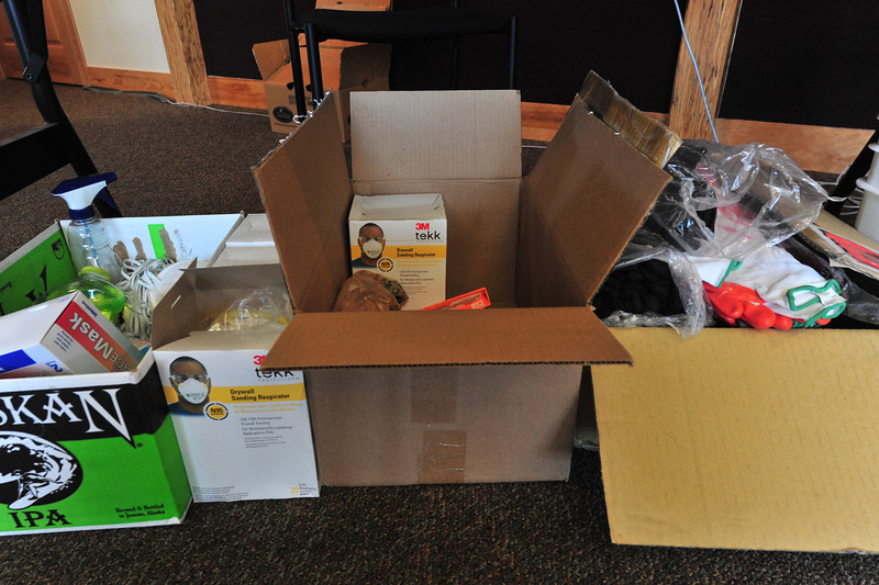 Boxes of gloves and masks sit in the volunteer clearing house at the Estes Park History Museum on Monday. Volunteers encounter dangerous and sometimes toxic substances when out helping to clean up.