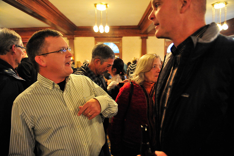 Larimer County Sherif Justin Smith talks with local business owner Todd Jirsa during the Mountain Strong Community Gathering on Friday at the Stanley Hotel. Smith lived in Estes Park before becoming sherif, and returns often.