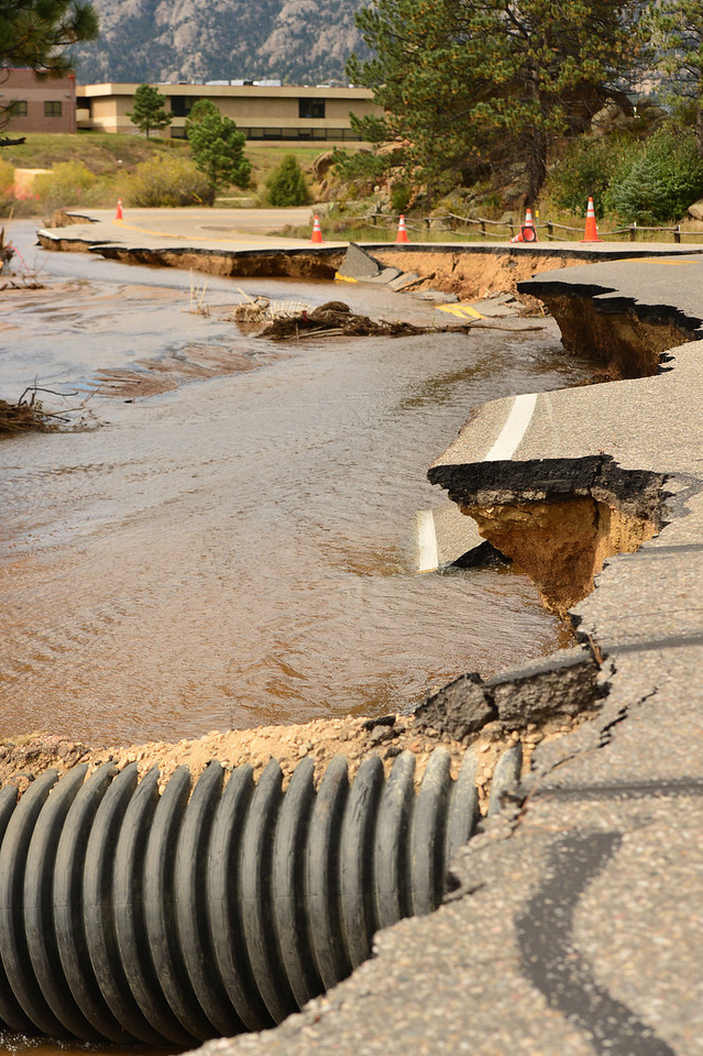 Large sections of Fish Creek Road lay in the creek on Monday ahead of repair efforts. The flooding took out the road and all of the pipes that follwed the road.