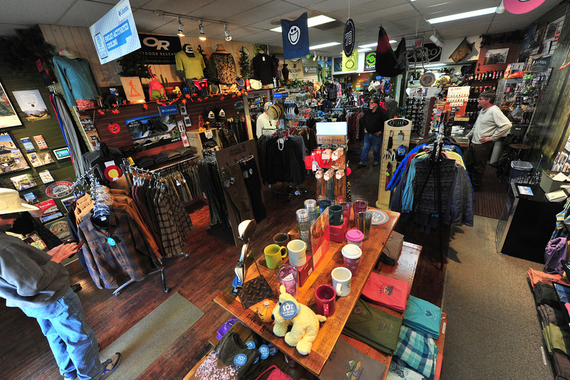 In spite of water and mud, several shops, like the Hiking Hut, have reopened. The shops of Estes Park now await customers.