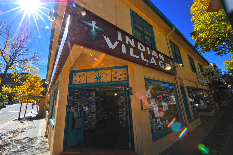 The iconic Indian Village draws visitors on a sunny Monday. The store had flood water lapping against steps of the front door, but had very little water inside, allowing the store to reopen quickly.
