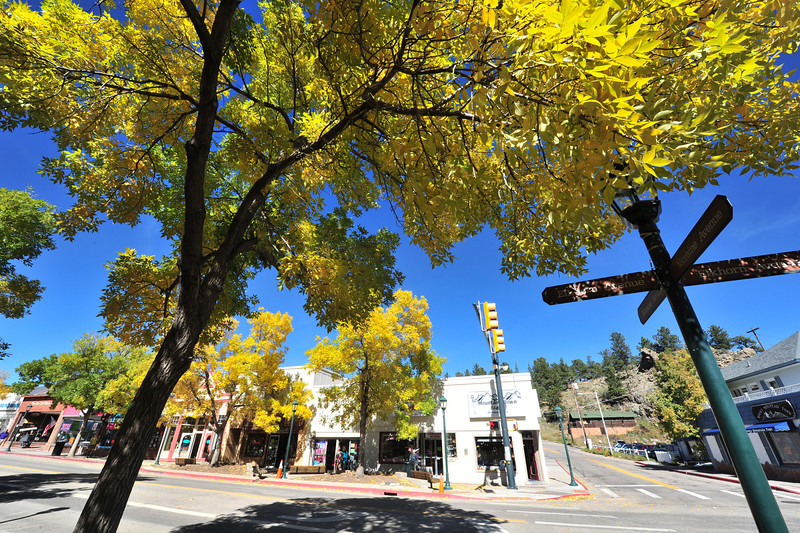 Trees in full fall display line Elkhorn Avenue on Monday. The trees add to the ex[erience of strolling between Estes Park's many shops.
