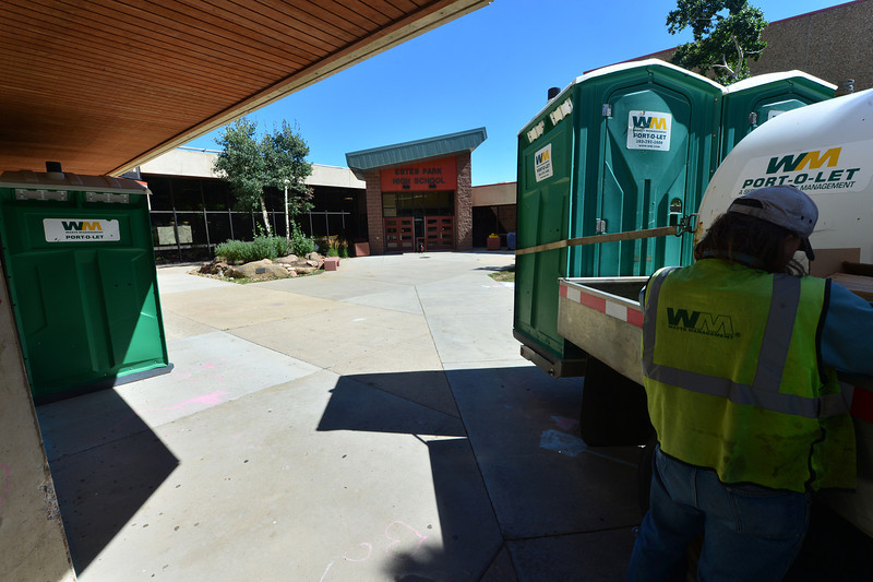 "Waste Mangement ""Porto-lets"" sit at the Estes Park High School on Monday. The poratable toilets were delivered as the school sits in the town's ""No-Flush"" zone."