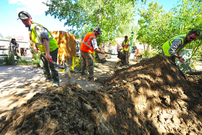 National park trails crews and Alpine Hot Shots help clean up the Riverwalk on Tuesday. The Estes Park area has a long recovery ahead, but many have already begun.