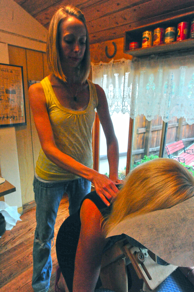 Sarah Busch applies some positive pressure at the Grubsteak restaurant on Wednesday. Therapists from the Elements of Touch Spa gave chair massages to help sore muscles and frazzled nerves.
