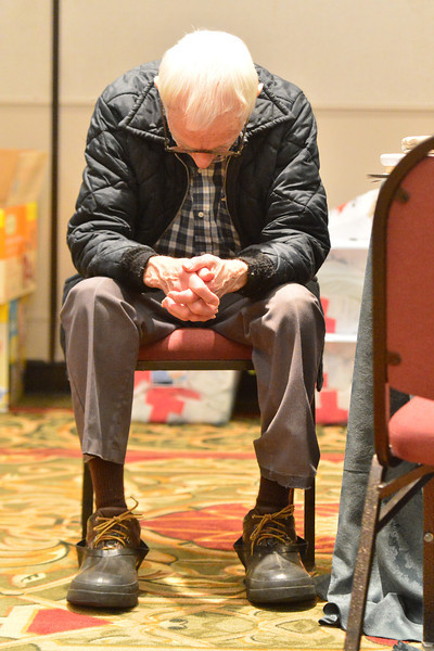 An elderly man seems dejected at the Red Cross shelter on Wednesday.