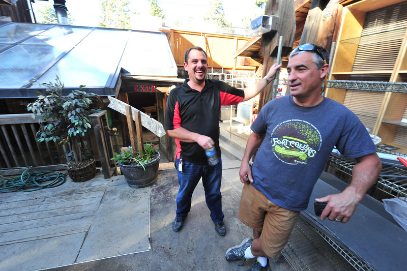 Tpry Nelson and Chuck Santagati laugh on Saturday over the lemons they were delt at the Wapiti Grill. The popular restaurant will have to be gutted and rebuilt from the inside before reopening.