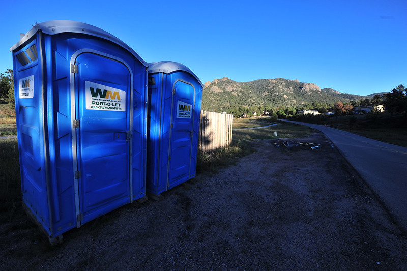 Waste Management Port-O-Lets sit along Carriage Drive on Friday. The portable toilets were stationed in neighborhoods in no-flush zones.