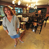 Julie Pieper looks nearly giddy as her restaurant dries out. Mama Rose's should reopen as soon as new flooring can by installed.