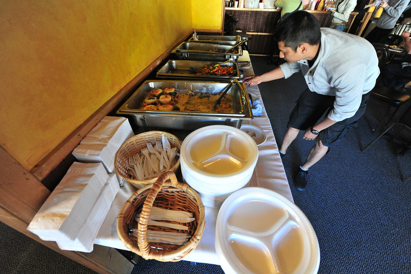 A Molly B's worker adjusts the steam tray on Breakfast on Friday. The restaurant hosted a volunteery donation breakfast, with money going to flood relief.