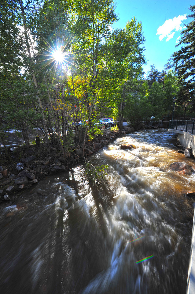 The Fall River rushes into Downtown Estes Park on Saturday. The river looks swift but pleasant within its banks.