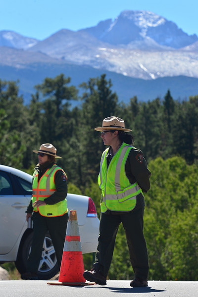 Park rangers man the road block at Bear Lake Road on Tuesday. The national park has closed much of the park to check for damage and make sure trails and roads are safe before allowing visitors back in.