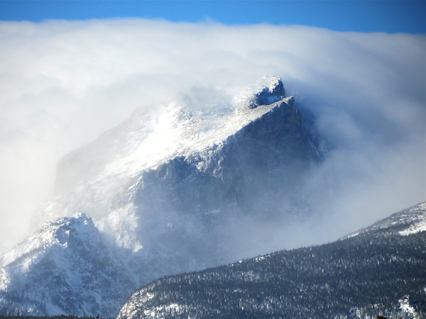 Hallet Peak located west of Beark Lake in Rocky Mountain National Park is shrouded in morning clouds.