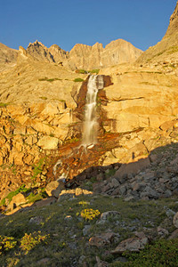 Longs Peak pierces the sky above Columbine Falls.
