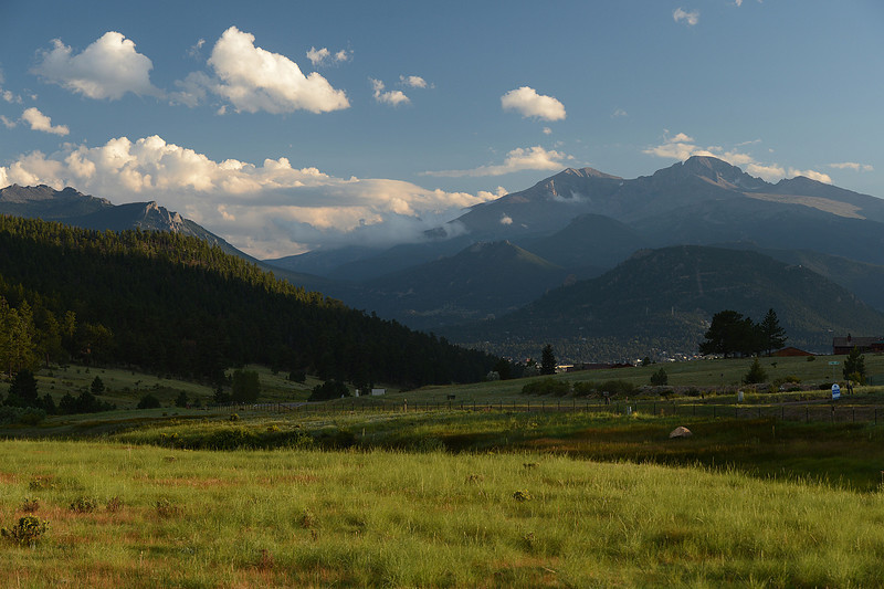 Skies clear over Estes Park as shadows stretch across the valley.