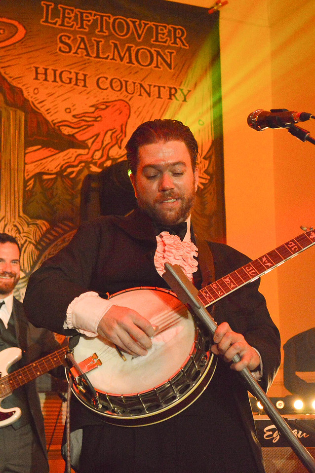 Leftover Salmon's Andy Thorn uses an axe to play his Banjo, Saturday March 14, at the Stanley Hotel Concert.