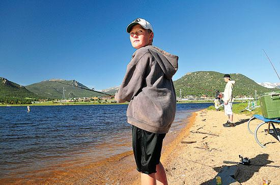 Logan Kittler, 10, of Longmont checks the competition at the annual Lake Estes Fishing Derby on Saturday.