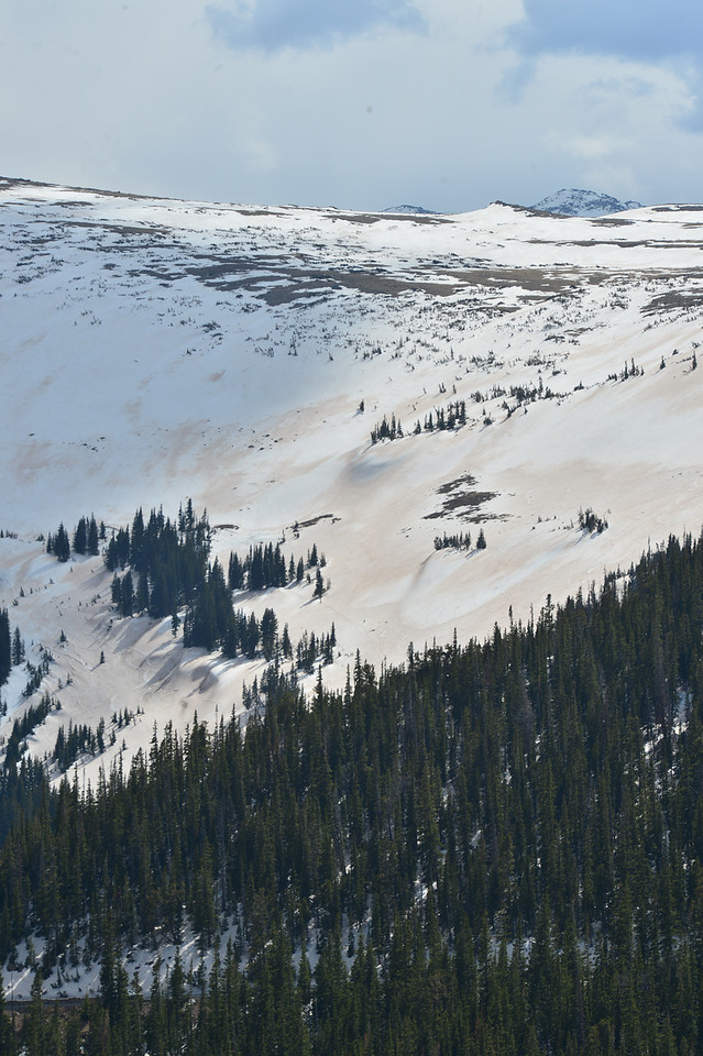 Discolored snow blankets the slope of the upper Hidden Valley bowl on Wednesday. The discoloring is a result of dust blown in from west of Estes Park and results an higher absorbtion of heat and faster melting.