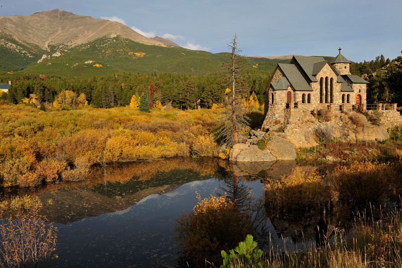 Walt Hester | Trail Gazette<br /> Autumn color surrounds the Chapel on the Rock at the St. Malo retreat along HWY 7 on Wednesday. St. Catherine of Siena's Chapel is one of the most photographed chapels in the state, with Mt. Meeker thrusting skyward behind it.