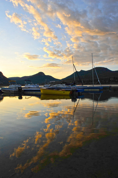 Walt Hester | Trail Gazette<br /> Wednesday's sunrise reflects off of Lake Estes before a cold front brought clouds and eventualy steady rain to Estes Park. While temperatures are expected to rebound Friday, sunshine may not return until Saturday.