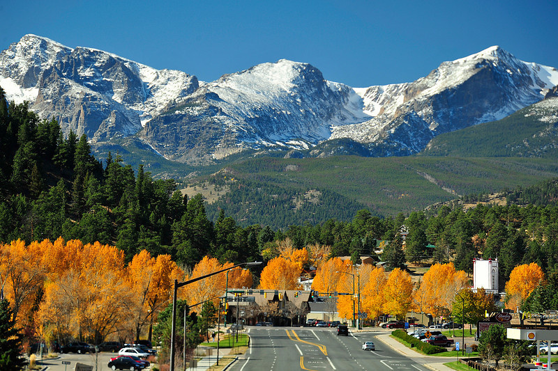 Autumn snow and golden foliage adorn the view of Estes Park from Big Thompson Avenue. Sunny and mild weather is expected to continue through the weekend.