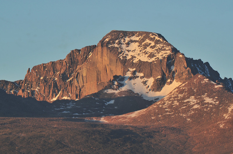 Longs Peak turns red in the early morning glow on Wednesday.