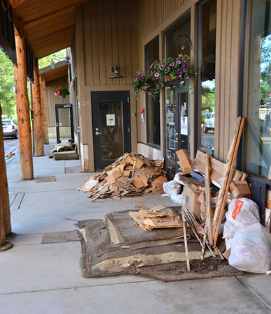 Flood debris is stacked outside businesses in the 500 block of W. Elkhorn.