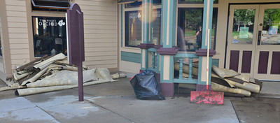 Flood debris, including carpet, is stacked outside the White Orchid in the 300 block of West Elkhorn.