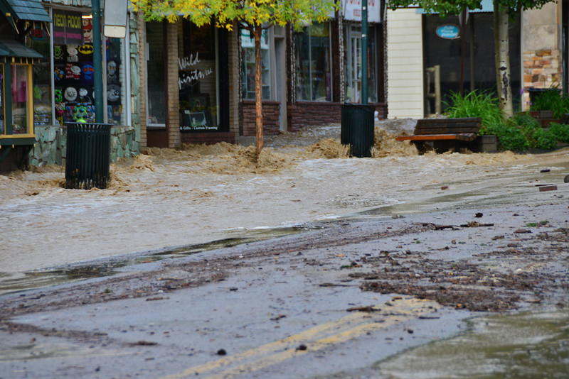 Floodwater rages down Elkhorn Avenue Friday morning, Sept. 13, in downtown Estes Park.