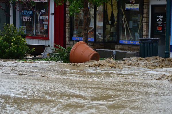 A flower pot near the intersection of Elkhorn and Moraine in downtown Estes Park lays on its side Friday morning, Sept. 13 after being displaced by floodwater.