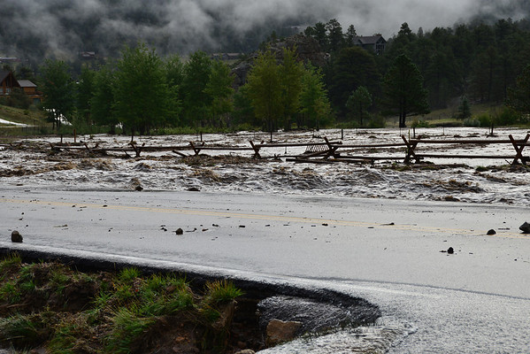 Floodwaters rage past Fish Creek Road near the intersection with Carriage Drive Friday morning, Sept. 13.