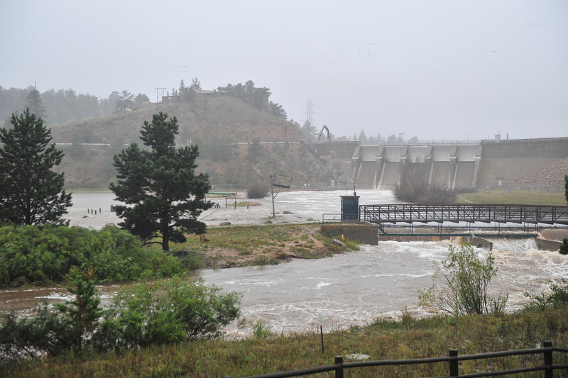 With the Olympus Dam floodgates open, the Big Thompson River inundates Wapiti Meadows. The increased flow may have kept Estes Park from even more flooding, but led to the collapse of a section of US 34 above Drake.