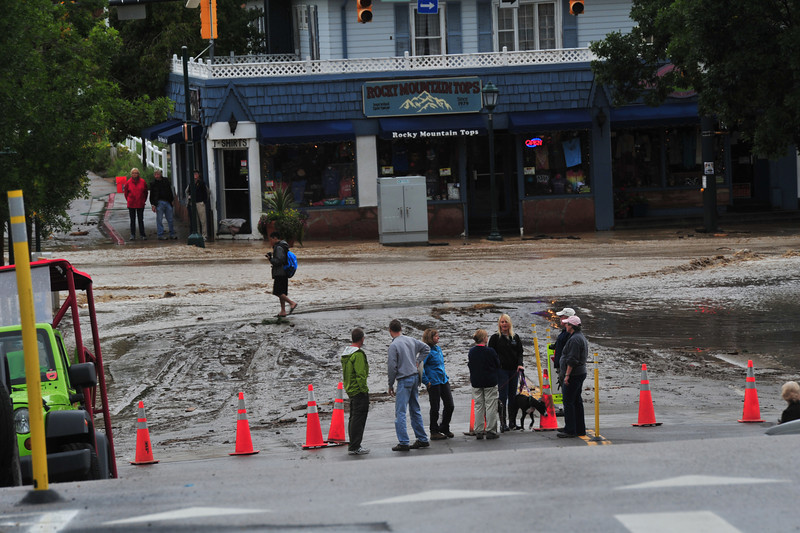 Curious residents check out rain and mud at Elkhorn and Moraine avenues on Friday.