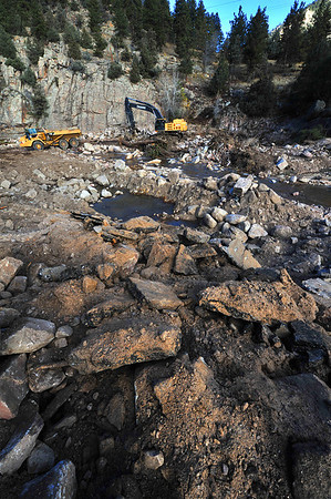 Heavy equipment operates in the new landscape at the entrence to Big Elk Meadows on Tuesday. While much of the Estes Park area is returning to normal, other areas, like Big Elk Meadows and Glen Haven, still have a long way to go.