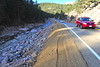 "Drivers glide along a stretch of ""temperary"" road along US 36 abone Pinewood Springs on Tuesday. While the road is open, state officials say more perminent repairs will be made next spring."