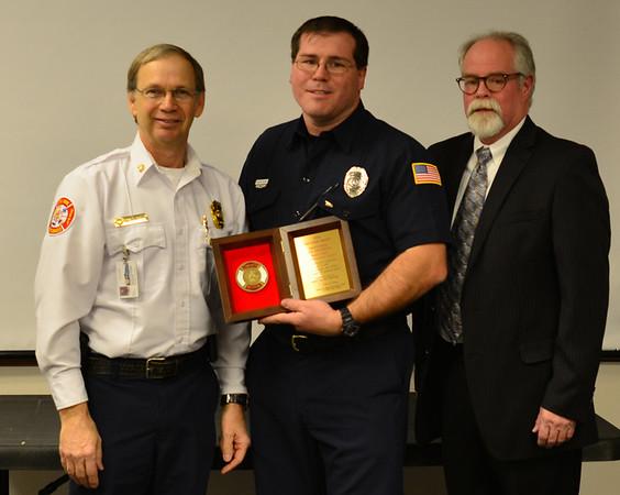 Fire Chief Scott Dorman, Dan Patterson and Barney Jones with Liberty Mutual Insurance.