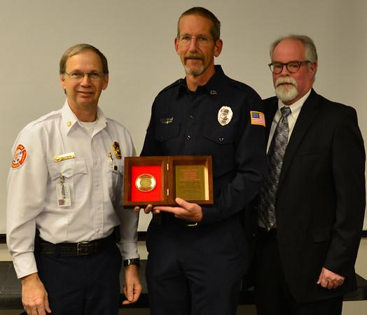 Fire Chief Scott Dorman, Scott Chew and Barney Jones with Liberty Mutual Insurance.