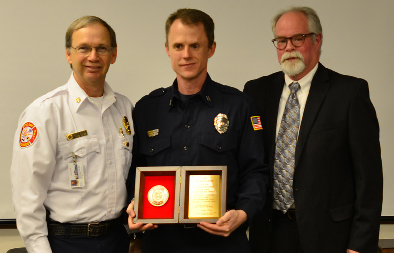 Fire Chief Scott Dorman, Derek Rosenquist  and Barney Jones with Liberty Mutual Insurance.