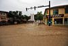 Brown floodwater rushes through the intersection of Elkhorn and Morain avenues on Friday. Town officials pointed out that the floodwater is untreated and not a safe place in which to splash around.