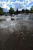 Water continues running through the parking lot at the public library on Saturday. The library is one of a few places with wi-fi internet, along with the evacuation centers and Notchtop cafe.