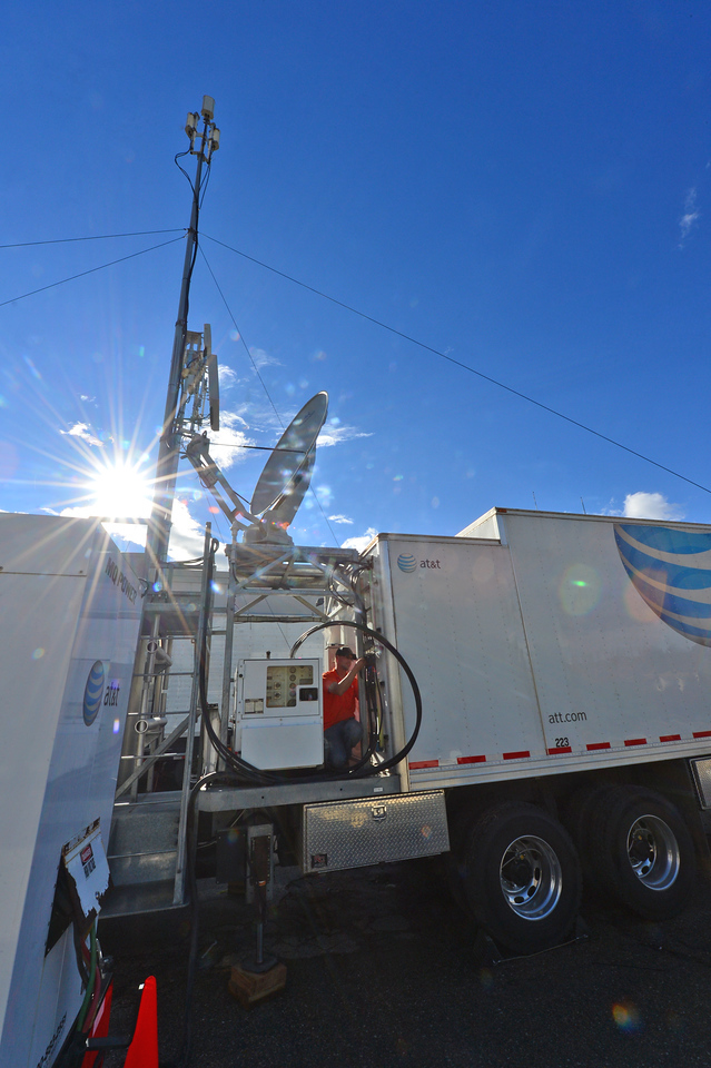 AT&T workers install a temporery tower to restor some cellular service in Estes Park.