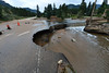 A sink hole compomises the road into the YMCA of the Rockies after the historic rain and flash flooding this week. The rains undercut several sections of Spur 66 and breached the dam that held back Dorsey Lake.
