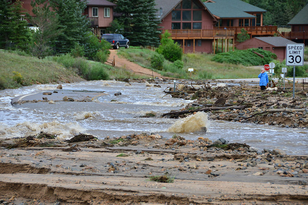 Fish Creek was a raging torent flowing down Fish Creek Road Saturday morning. Officials said as of Saturday the creek had breached its banks in nine locations.
