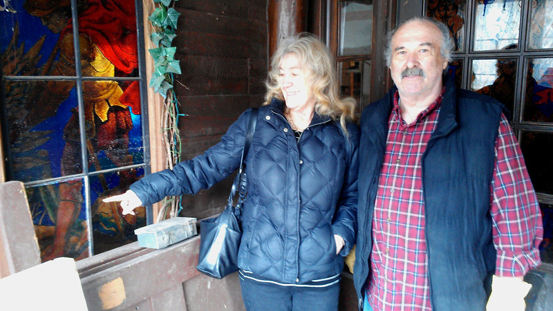 Sheila points to a panel in the a stain glass window, that was pushed out but miraculously, found unharmed.  Sheila and Tom Sellers have owned the Inn of Glen Haven since 1989.