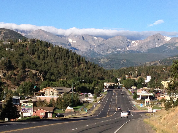 06ep downtown estes.jpg Clouds cling low over the peaks of the Continental Divide on Friday. Cooler weather is expected today, highs in the low 70s and afternoon showers again expected.