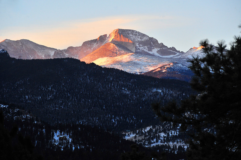 Longs Peak catches the glow of first light on Christmas Day. Weekend weather should be mostly clear with highs in the high 30s and low 40s.
