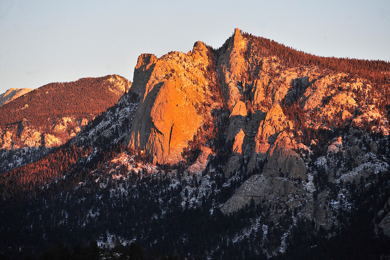 The Sundance Buttress glows with the first light of Christmas Morning. The beauty of Estes Park was enough to draw the Governor to town for the holiday.