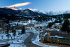 The first light of Christmas day warms Longs Peak while the rest of Estes Park remains in cool colors and temperatures. The weekend should be relatively warm, with sunshine and temperatures in the mid 30s to low 40s.