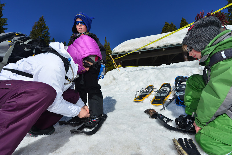 Brennan, 5, and Braden, 8 of Pueblo get help from mom, Nancy Madina, before setting out on the snowy trails in Rocky Mountain National Park on Tuesday. The impressive snow totals for the season have brought visitors to the Bear Lake trails from as far away as Illinois.